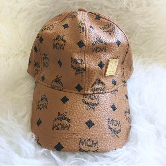 6617afb708a3f ... italy bucket hat lyst mcm cognac studded stark cap in natural mcm mcm  hat from dealss